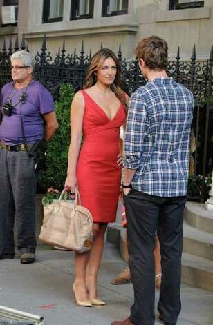 "In this Wednesday, July 13, 2011 photo, actress Elizabeth Hurley, left, and Chace Crawford are shown on the set of ""Gossip Girl"" on Manhattan's Upper East Side in New York. Hurley will play a media mogul named Diana Payne in a multi-episode arc on the popular CW series. Photo: Darla Khazei, AP Photo / AP2011"