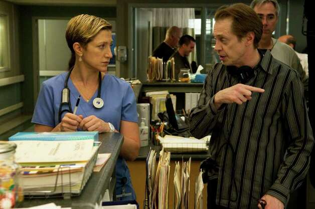 "In this image released by Showtime, Steve Buscemi, right, talks with Edie Falco who stars in the title roll in the Showtime series, ""Nurse Jackie,"" currently in production in New York.  Buscemi directs several episodes of the network's newest dark comedy starring Falco as an emergency room nurse working in the complicated and frenzied environment of a New York hospital.  A lapsed Catholic with a weakness for painkillers to get her through the days, she keeps the hospital balanced with her unique bedside manner and own brand of medical justice. The program will premiere in June. Photo: Ken Regan, AP Photo / AP2008"