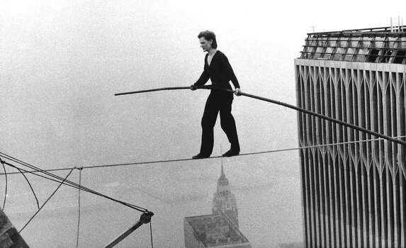 "In this Aug. 7, 1974 file photo, Philippe Petit, a French high wire artist, walks across a tightrope suspended between the World Trade Center's Twin Towers in New York.  Philippe Petit stars in ""Man on a Wire,"" directed by James Marsh. Photo: Alan Welner, AP Photo / AP1974"
