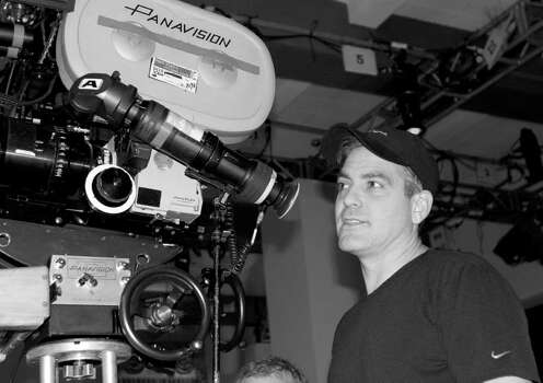 "This undated photo released by Warner Independent Pictures, shows actor-director George Clooney on the set of ""Good Night and Good Luck."" Clooney picked up three Oscar nominations Tuesday, Jan. 31, 2006.  Clooney was nomated for best supporting actor for his role as a steadfast undercover CIA agent in ""Syriana"" and best director and co-writer for his Edward R. Murrow tale ""Good Night, and Good Luck."" Photo: MELINDA SUE GORDON, AP Photo / AP2005"