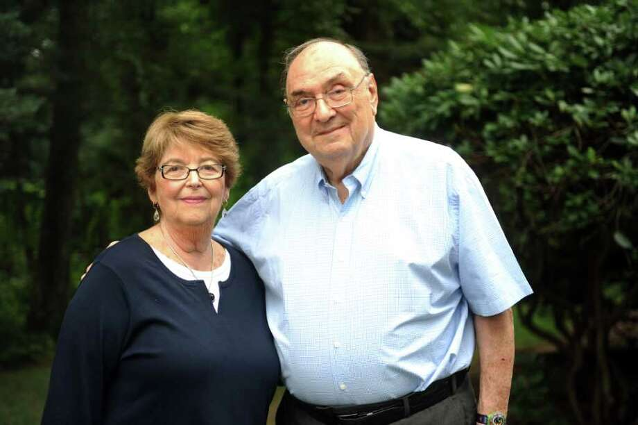 Rosalind and Arthur Friedman, of Trumbull, were travelling by airplane when the Twin Towers were attacked.  Their flight was rerouted to Canada where they spent five days before returning home to Connecticut. Photo: Autumn Driscoll / Connecticut Post