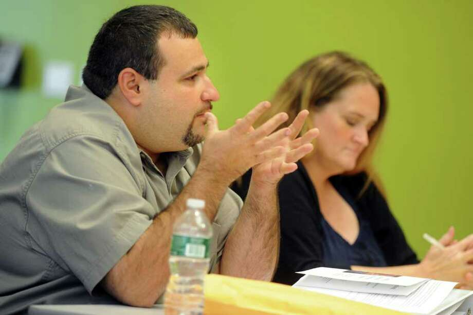 Hernan Illingworth, a member of the state-appointed Bridgeport Board of Education, talks with other board members Thursday, Aug. 18, 2011 during a special meeting of the board at Housatonic Community College in Bridgeport, Conn. Photo: Autumn Driscoll / Connecticut Post