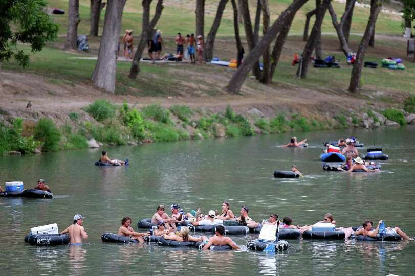 Tubers enjoy the Guadalupe River at the fourth crossing Saturday Aug. 13, 2011 in New Braunfels, TX.