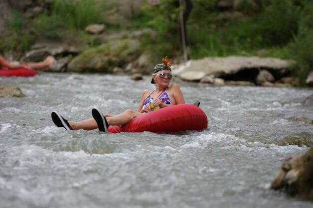 Mandy Queen enjoys a section of the Guadalupe River horseshoe Saturday Aug. 13, 2011 in New Braunfels, TX. Photo: EDWARD A. ORNELAS, EDWARD A. ORNELAS / Eaornelas@express-news.net / © SAN ANTONIO EXPRESS-NEWS (NFS)