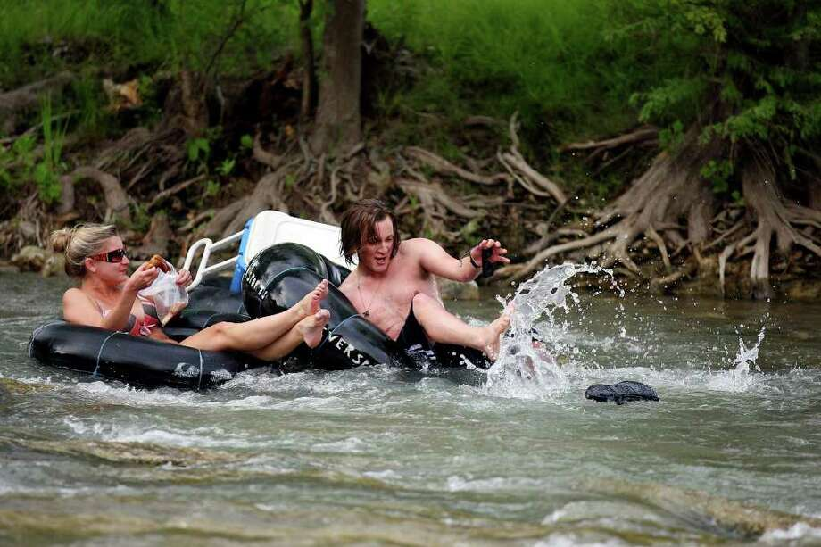 Tubers enjoy a section of the Guadalupe River horseshoe Saturday Aug. 13, 2011 in New Braunfels, TX. Photo: EDWARD A. ORNELAS, EDWARD A. ORNELAS / Eaornelas@express-news.net / © SAN ANTONIO EXPRESS-NEWS (NFS)