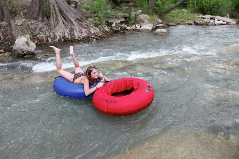 A tuber enjoy a section of the Guadalupe River horseshoe Saturday Aug. 13, 2011 in New Braunfels, TX