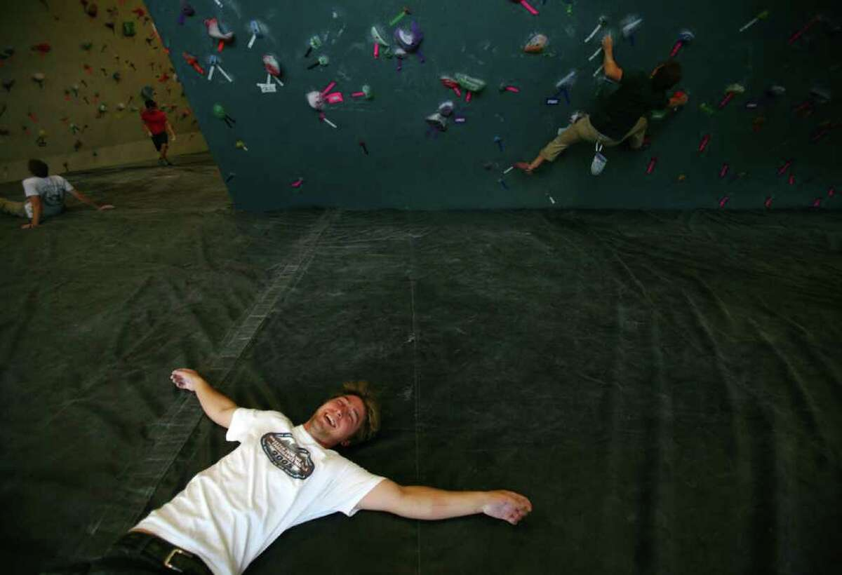 Mike White rests on the padded floor after a climb at the Seattle Bouldering Project. The Seattle Bouldering Project is a unique indoor climbing gym. Ropes are not used at the gym and climbers that fall land on 16 inch deep pads on the floor.