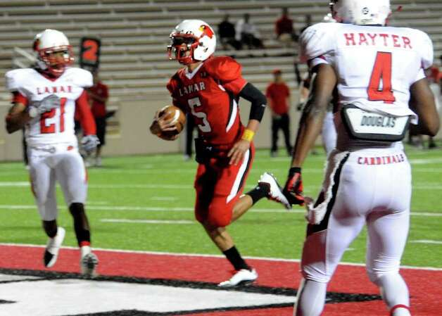 Lamar's Andre Bevil runs into the endzone for the Red team during the Crawfish Bowl at the Provost Umphrey Stadium at Lamar in Beaumont, Thursday. Tammy McKinley/The Enterprise Photo: TAMMY MCKINLEY / Beaumont