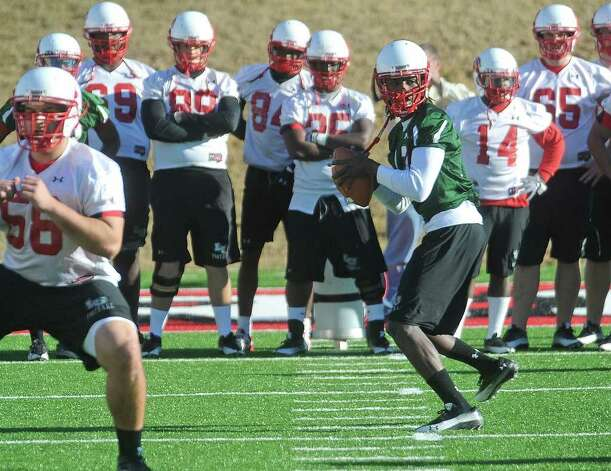 Lamar's Jeremy Johnson steps back to throw the ball during the Cardinal's first spring practice on Monday. Guiseppe Barranco/The Enterprise Photo: Guiseppe Barranco / Beaumont