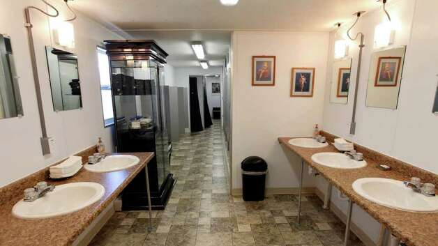 FOR BIZ - View of the mens restroom and showers at the Remote Logistics International, LLC Three Rivers Lodge Thursday Aug. 19, 2011 in Three Rivers, TX. (PHOTO BY EDWARD A. ORNELAS/eaornelas@express-news.net) Photo: EDWARD A. ORNELAS, SAN ANTONIO EXPRESS-NEWS / © SAN ANTONIO EXPRESS-NEWS (NFS)