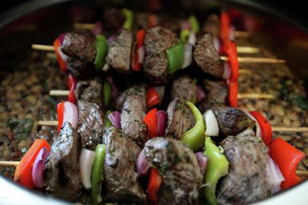FOR BIZ - Lamb kebabs during lunch at the Remote Logistics International, LLC Three Rivers Lodge Thursday Aug. 19, 2011 in Three Rivers, TX. (PHOTO BY EDWARD A. ORNELAS/eaornelas@express-news.net) Photo: EDWARD A. ORNELAS, SAN ANTONIO EXPRESS-NEWS / © SAN ANTONIO EXPRESS-NEWS (NFS)