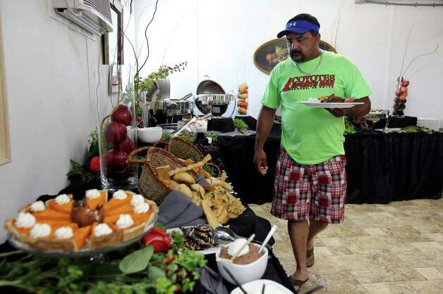 Supreme Services oil field worker Greg Martinez looks over the lunch buffet at the Remote Logistics International, LLC Three Rivers Lodge Thursday Aug. 19, 2011 in Three Rivers, TX.  Photo: EDWARD A. ORNELAS, SAN ANTONIO EXPRESS-NEWS / © SAN ANTONIO EXPRESS-NEWS (NFS)