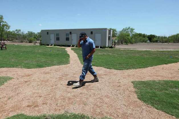 FOR BIZ - Supreme Services oil field worker Freddy Trevino walks to lunch at the Remote Logistics International, LLC Three Rivers Lodge Thursday Aug. 19, 2011 in Three Rivers, TX. (PHOTO BY EDWARD A. ORNELAS/eaornelas@express-news.net) Photo: EDWARD A. ORNELAS, SAN ANTONIO EXPRESS-NEWS / © SAN ANTONIO EXPRESS-NEWS (NFS)
