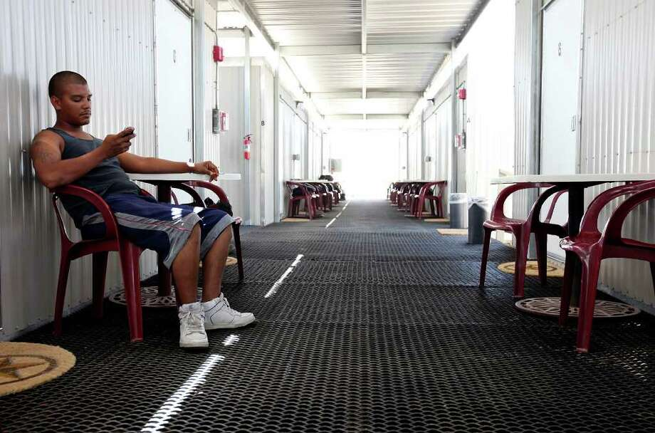 Coil Tubing Services oil field worker Ramon Baiza relaxes at the Remote Logistics International, LLC Three Rivers Lodge after a shift Thursday Aug. 19, 2011 in Three Rivers, TX.  Photo: EDWARD A. ORNELAS, SAN ANTONIO EXPRESS-NEWS / © SAN ANTONIO EXPRESS-NEWS (NFS)