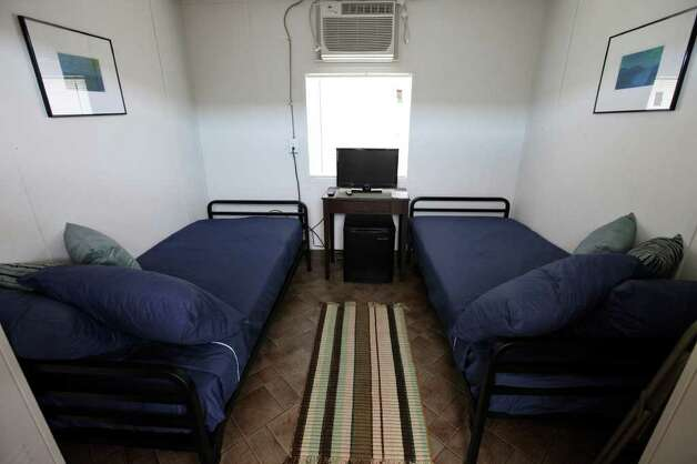 View of a double bed room at the Remote Logistics International, LLC Three Rivers Lodge Thursday Aug. 19, 2011 in Three Rivers, TX. The RLI Three Rivers Lodge also offers quad bed and VIP single suites.  Photo: EDWARD A. ORNELAS, SAN ANTONIO EXPRESS-NEWS / © SAN ANTONIO EXPRESS-NEWS (NFS)