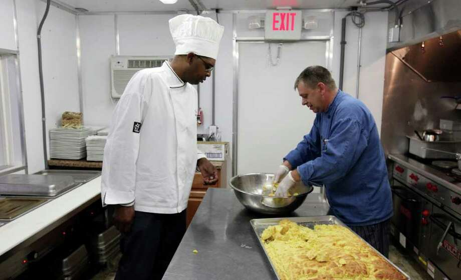 FOR BIZ - Remote Logistics International, LLC Executive Chef Will Smith (left) and RLI Three Rivers Lodge Chef Frank Bullock prepare cornbread dressing for a turkey dinner Thursday Aug. 19, 2011 at the RLI Three Rivers Lodge in Three Rivers, TX. (PHOTO BY EDWARD A. ORNELAS/eaornelas@express-news.net) Photo: EDWARD A. ORNELAS, SAN ANTONIO EXPRESS-NEWS / © SAN ANTONIO EXPRESS-NEWS (NFS)