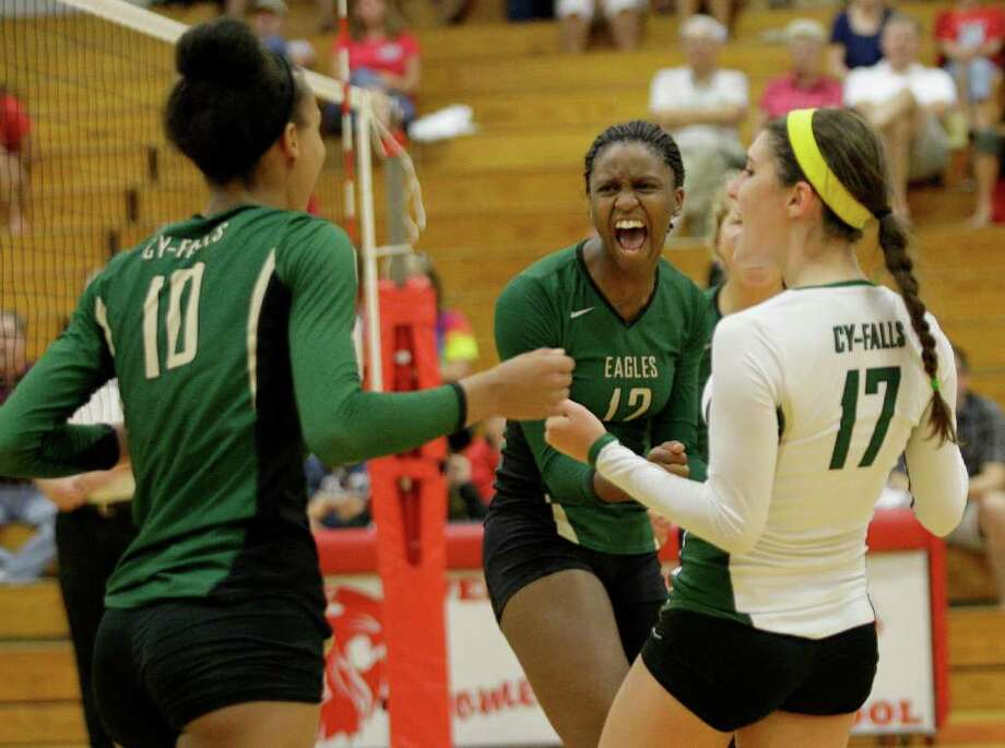 Cy Falls' Mylan Eugene, left,  and Alex Austin celebrate winning the second set. Photo: Thomas B. Shea, For The Chronicle