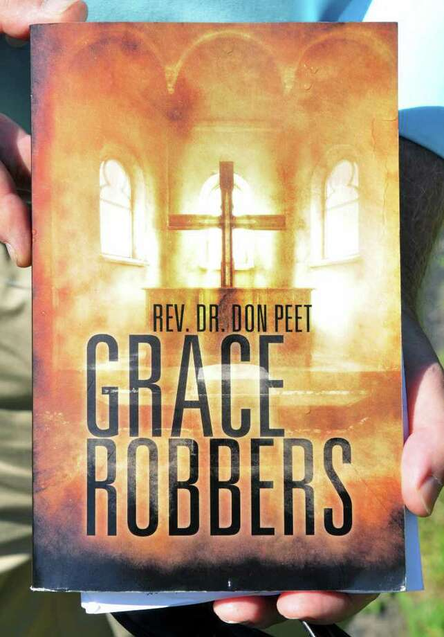 "Rev. Don Peet's book ""Grace Robbers"" Friday Aug. 12, 2011.   (John Carl D'Annibale / Times Union) Photo: John Carl D'Annibale / 00014249A"