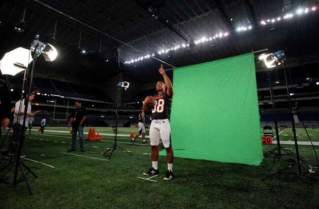 Safety Shane Jones (38) gestures for the cameras during Media Day for the UTSA football program at the Alamodome on Friday, August 19, 2011. Players had their photographs taken and were interviewed in anticipation of the school's first football game in two weeks. Kin Man Hui/kmhui@express-news.net Photo: KIN MAN HUI, Express-News / San Antonio Express-News
