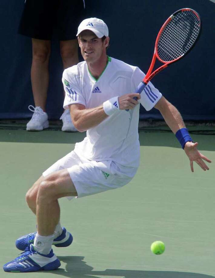 Andy Murray, from Great Britain, hits a forehand against Gilles Simon, from France, during a quarterfinal match at the Western & Southern Open tennis tournament, Friday, Aug. 19, 2011 in Mason, Ohio. (AP Photo/Al Behrman) Photo: Al Behrman