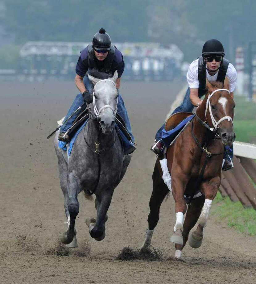 Travers entrant Rattlesnake Ridge, left with exercise rider Danny Wright gets his final speed workout before the Mid Summer Derby at the Saratoga Springs, N.Y. Aug. 19, 2011.    (Skip Dickstein / Times Union) Photo: SKIP DICKSTEIN