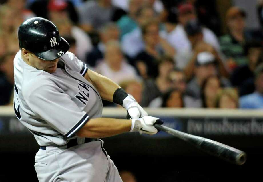 MINNEAPOLIS, MN - AUGUST 19: Russell Martin #55 of the New York Yankees hits a two run home run against the Minnesota Twins in the sixth inning on August 19, 2011 at Target Field in Minneapolis, Minnesota. (Photo by Hannah Foslien/Getty Images) Photo: Hannah Foslien