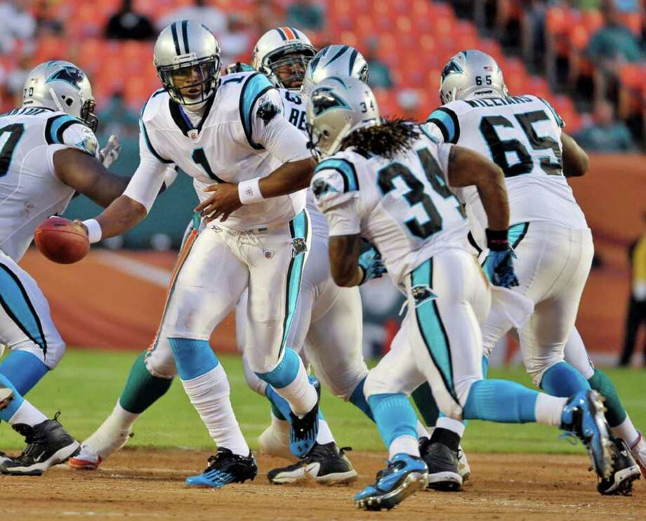 Carolina Panthers quarterback Cam Newton (1) looks to handoff the ball running back DeAngelo Williams during the first half of an NFL preseason football game against the Miami Dolphins,  Friday, Aug. 19, 2011, in Miami. (AP Photo/Gary I. Rothstein) Photo: Gary I. Rothstein