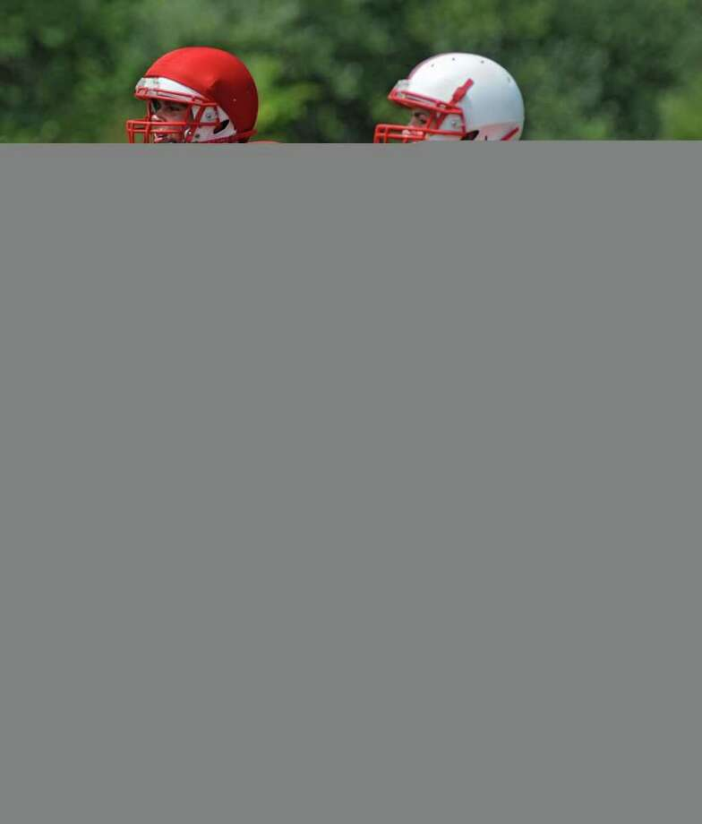 Mechanicville football players and brothers Chris, left, and Nate Hatalsky run during practice in Mechanicville, N.Y. on Friday, Aug. 19, 2011. (Lori Van Buren / Times Union) Photo: Lori Van Buren
