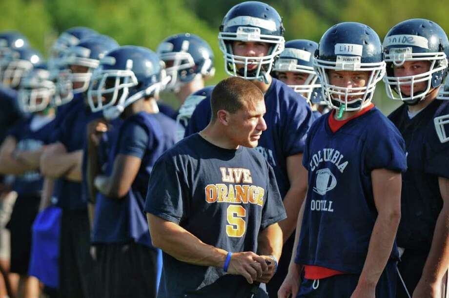 High school football -- Columbia High School football coach Craig Cavotta with his players during practice on Tuesday Aug. 16, 2011 in East Greenbush, NY.    (Philip Kamrass / Times Union) Photo: Philip Kamrass / 00014289A