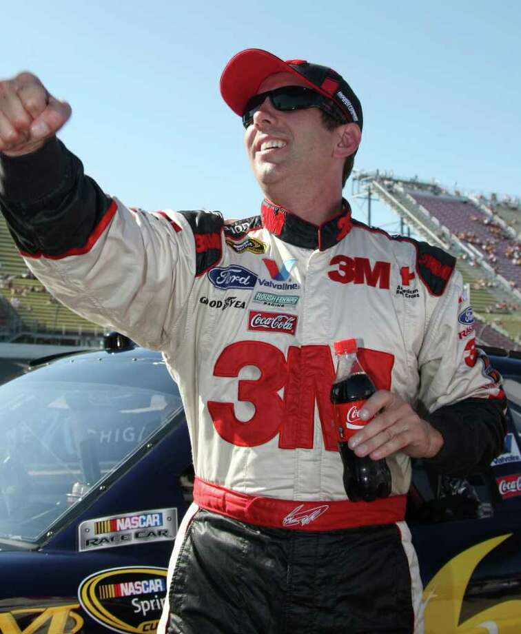 Greg Biffle pumps his fist after winning the pole during qualifications for Sunday's NASCAR Sprint Cup Series auto race at Michigan international Speedway in Brooklyn, Mich., Friday, Aug. 19, 2011. (AP Photo/Bob Brodbeck) Photo: Bob Brodbeck