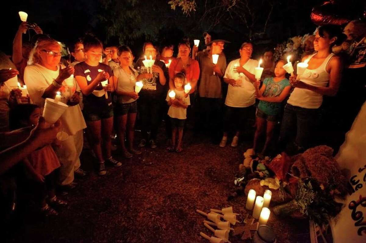 Family and friends of Rudy Alejos gather for a candlelight vigil to remember the 6-year-old who died in a fire at his home at the Summerville Apartments. At least 80 people gathered at the scene where the autistic yet bright child perished in a fire. His grandmother, Sylvia Morales (far left) and his aunt, Belinda Garcia (far right), were amongst the small crowd that gathered at the site.