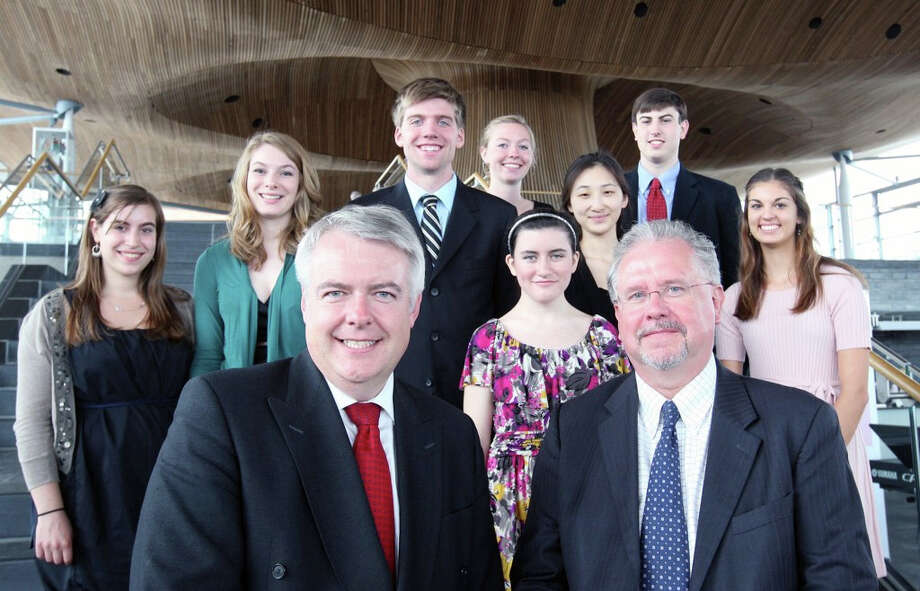 The First Minister of Wales Carwyn Jones, left, with Professor Jonathan Osmond. Behind them are, from left, Jordan Shapiro (University of Rochester), Alyssa Hartman (Ball State University), Jacob Peters (Northwestern University), Angela Edwards (Seattle University), Kathryn Cannon (Illinois Wesleyan University), Catherine Yu (Carnegie Mellon University), Michael Borchetta (Northwestern University), Ila Jones (University of South Florida). Photo: Contributed Photo