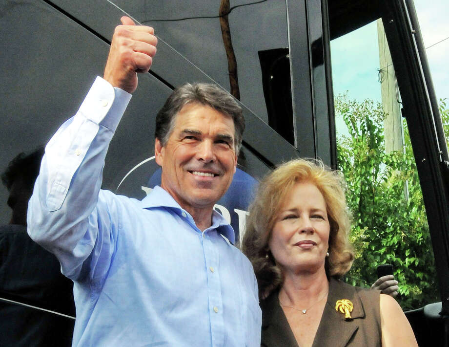 Gov. Rick Perry, with wife, Anita, gives a thumbs up to supporters Saturday at Tommy's Ham House in Greenville, S.C. (AP Photo/ Richard Shiro) Photo: Richard Shiro / Associated Press