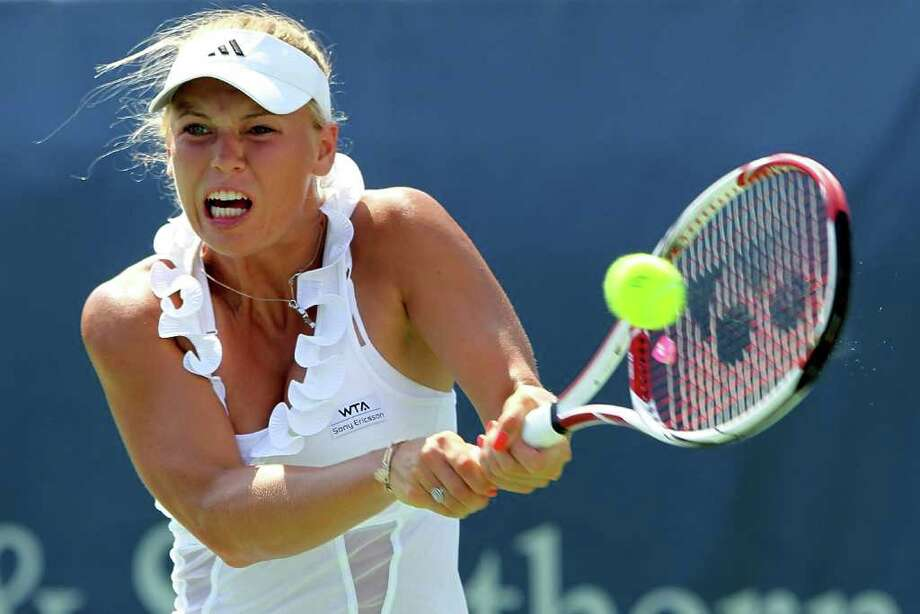 MASON, OH - AUGUST 17:  Caroline Wozniacki of Denmark returns a shot to Christina McHale during the Western & Southern Open at the Lindner Family Tennis Center on August 17, 2011 in Mason, Ohio.  (Photo by Matthew Stockman/Getty Images) Photo: Matthew Stockman, Getty / 2011 Getty Images