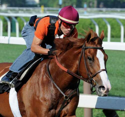 Preakness Stakes winner Shackleford with regular jockey Jesus Castanon goes out for his final major work before the Travers Stakes at the Saratoga Springs, N.Y. Aug. 19, 2011.    (Skip Dickstein / Times Union) Photo: SKIP DICKSTEIN