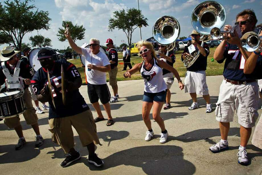 Jennifer Patterson dances with  Houston Texans Bullpen Pep Band while tailgating before an NFL preseason football game against the New Orleans Saints at Reliant Stadium. Photo: Smiley N. Pool, Houston Chronicle / © 2011 Houston Chronicle