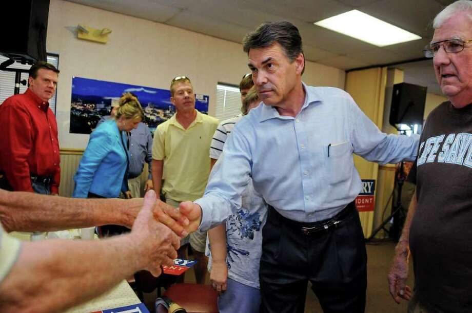 Perry greets supporters at Tommy's Ham House in Greenville, S.C., on Saturday. (AP Photo/ Richard Shiro) Photo: RICHARD SHIRO, FRE / FR159523 AP