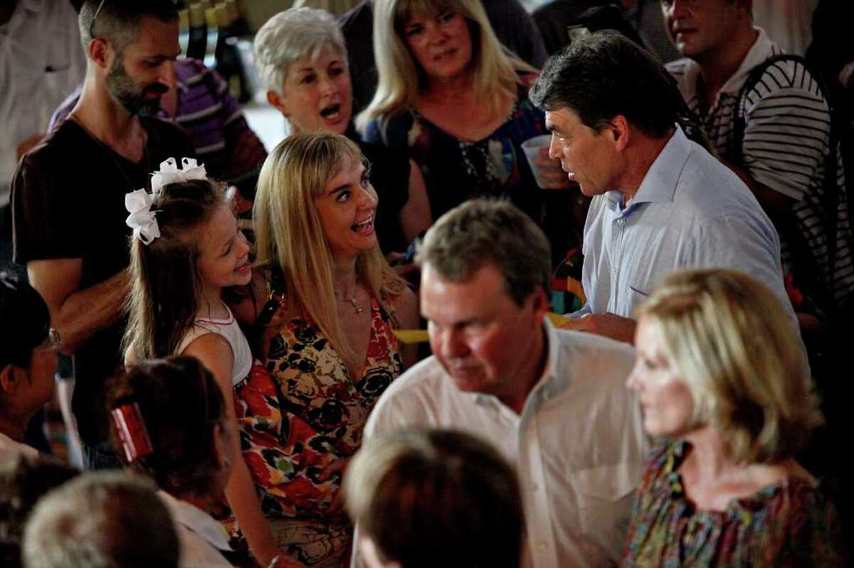 Metro - Governor Rick Perry greets supporters in the overflow crowd room during his Welcome Home Rally at Abel's on the Lake in Austin on Saturday, August 20, 2011. LISA KRANTZ/lkrantz@express-news.net