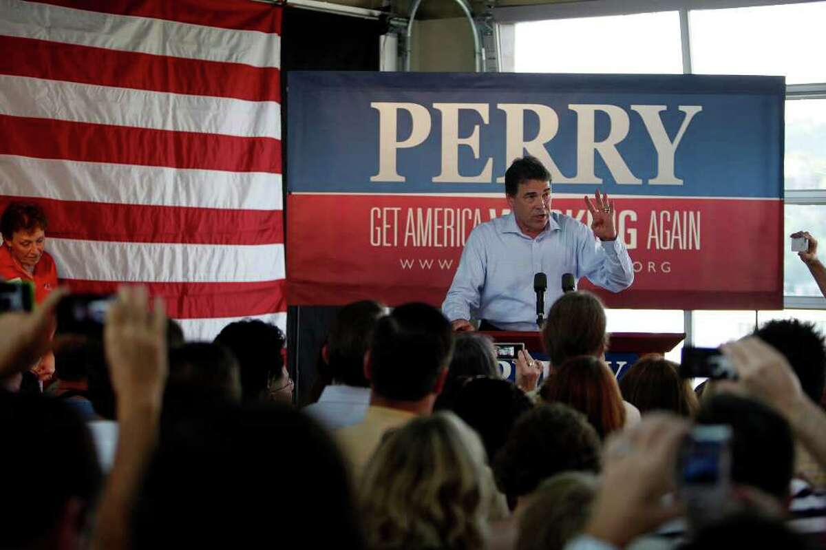 Metro - Governor Rick Perry speaks during his Welcome Home Rally at Abel's on the Lake in Austin on Saturday, August 20, 2011. LISA KRANTZ/lkrantz@express-news.net
