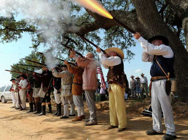 Re-enactors dressed as participants in the Battle of Medina fire a musket volley during a ceremony on Saturday, Aug. 20, 2011, commemorating the 198th anniversary of the Battle of Medina. The event was sponsored by the Texas Society - Sons of the American Revolution. The Battle of Medina was fought on Aug. 18, 1813, when a Spanish army, attempting to win Texas from the Republican Army of the North, which was supported by the United States and included veterans of the American Revolution, won a battle fought south of San Antonio near Espey. It is thought that about 800 Republicans died in the battle. Photo: BILLY CALZADA, BILLY CALZADA / Gcalzada@express-news.net / gcalzada@express-news.net