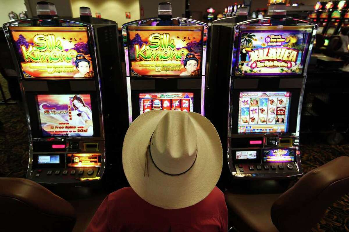 Jules Jourde, a rancher from Bandera County, plays the slot machines at the Lucky Eagle Casino on the Kickapoo Tribe Reservation in Eagle Pass, Tuesday, Aug. 9, 2011. The casino is undergoing an expansion that is part of a $90 million improvement project at the reservation. The casino addition will include a 250-room hotel.