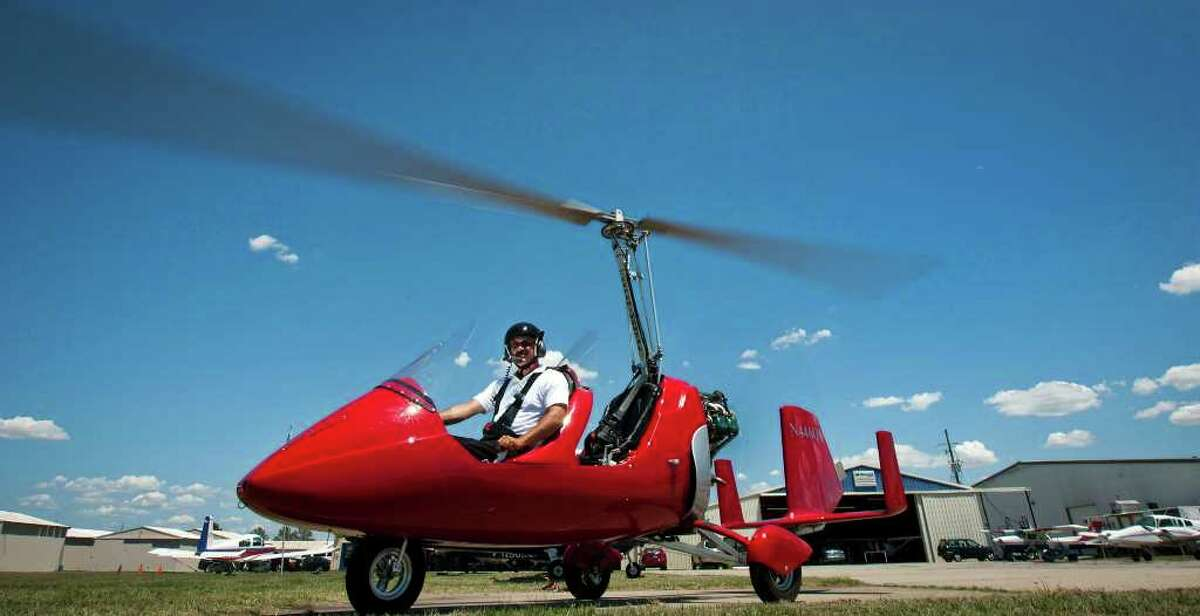 Desmon Butts, president of Texas AutoGyro and Light Sport, shows off his Gyrocopter at Hooks Airport near Tomball. The German-designed machine is one of only four in the U.S. ( Patrick T. Fallon / Houston Chronicle )