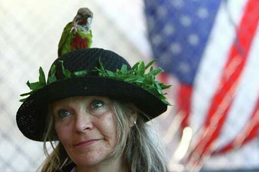 Pancreatic cancer patient and medical marijuana user Mellody Gannonlets her bird Hugs sit on her head at Seattle Hempfest on Saturday, August 20, 2011. The pro-pot festival is billed as the largest pro-pot festival in the country and on Saturday featured Seattle Mayor Mike McGinn and U.S. Rep. Dennis Kucinich. This was the first year the festival spanned three days. Photo: JOSHUA TRUJILLO / SEATTLEPI.COM