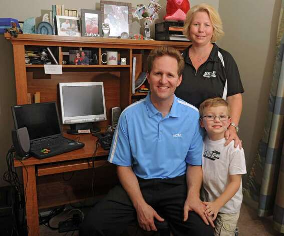 Tracy, left, and Ann King with their 6-year-old son Robert in their home office in Halfmoon, N.Y. on Wednesday, Aug. 17, 2011. Tracy King is the new commissioner of the Liberty League. Ann is the sports information director at The Sage Colleges. (Lori Van Buren / Times Union) Photo: Lori Van Buren