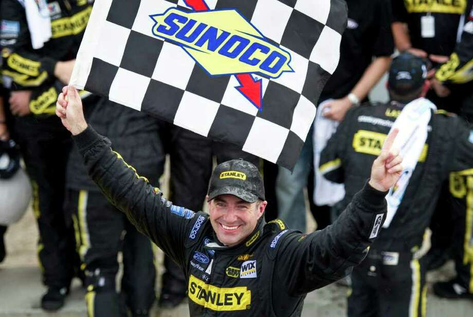 CORRECTS NAME OF PHOTOGRAPHER IN CAPTION - Marcos Ambrose, from Australia, celebrates his victory at the NAPA Auto Parts 200 NASCAR Nationwide Series auto race Saturday, Aug. 20, 2011, in Montreal. (AP Photo/The Canadian Press, Paul Chiasson) Photo: Paul Chiasson