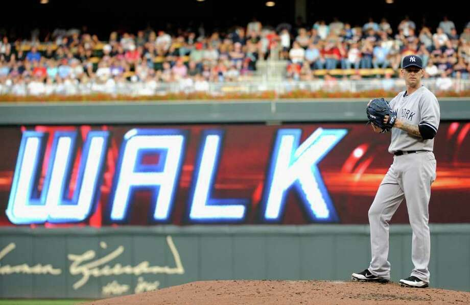 MINNEAPOLIS, MN - AUGUST 20: A.J. Burnett #34 of the New York Yankees reacts to walking Joe Mauer #7 of the Minnesota Twins to fill the bases in the second inning on August 20, 2011 at Target Field in Minneapolis, Minnesota. (Photo by Hannah Foslien/Getty Images) Photo: Hannah Foslien