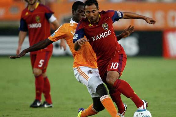 HOUSTON, TX - AUGUST 20: Arturo Alvarez #10 of Real Salt Lake moves the ball past Je-Vaughn Watson #10 of the Houston Dynamo at Robertson Stadium on August 20, 2011 in Houston, Texas.