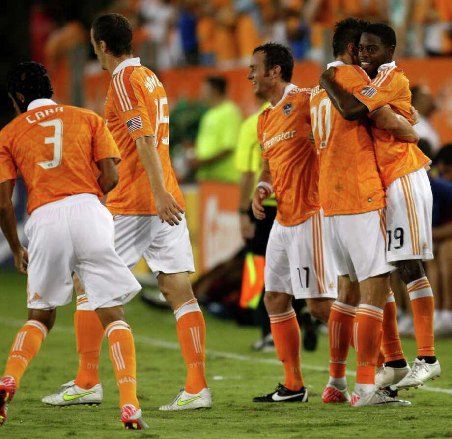 Alex Dixon (19) hugs teammate Geoff Cameron after scoring the game-winning goal in stoppage time. Photo: Eric Christian Smith, Getty / 2011 Getty Images
