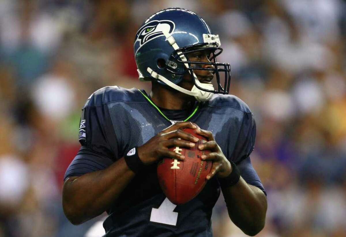 Seattle Seahawks quarterback Tarvaris Jackson prepares to throw the ball against the Minnesota Vikings during a preseason game at CenturyLink Field in Seattle on Saturday, Aug. 20, 2011. The Hawks fell to the Vikings 20-7.