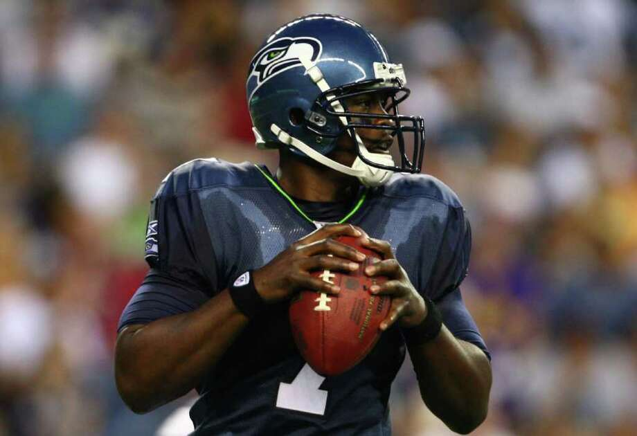 Seattle Seahawks quarterback Tarvaris Jackson prepares to throw the ball against the Minnesota Vikings during a preseason game at CenturyLink Field in Seattle on Saturday, Aug. 20, 2011. The Hawks fell to the Vikings 20-7. Photo: JOSHUA TRUJILLO / SEATTLEPI.COM